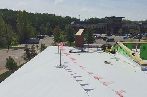 Thermoplastic roofing installed on roof of mall building