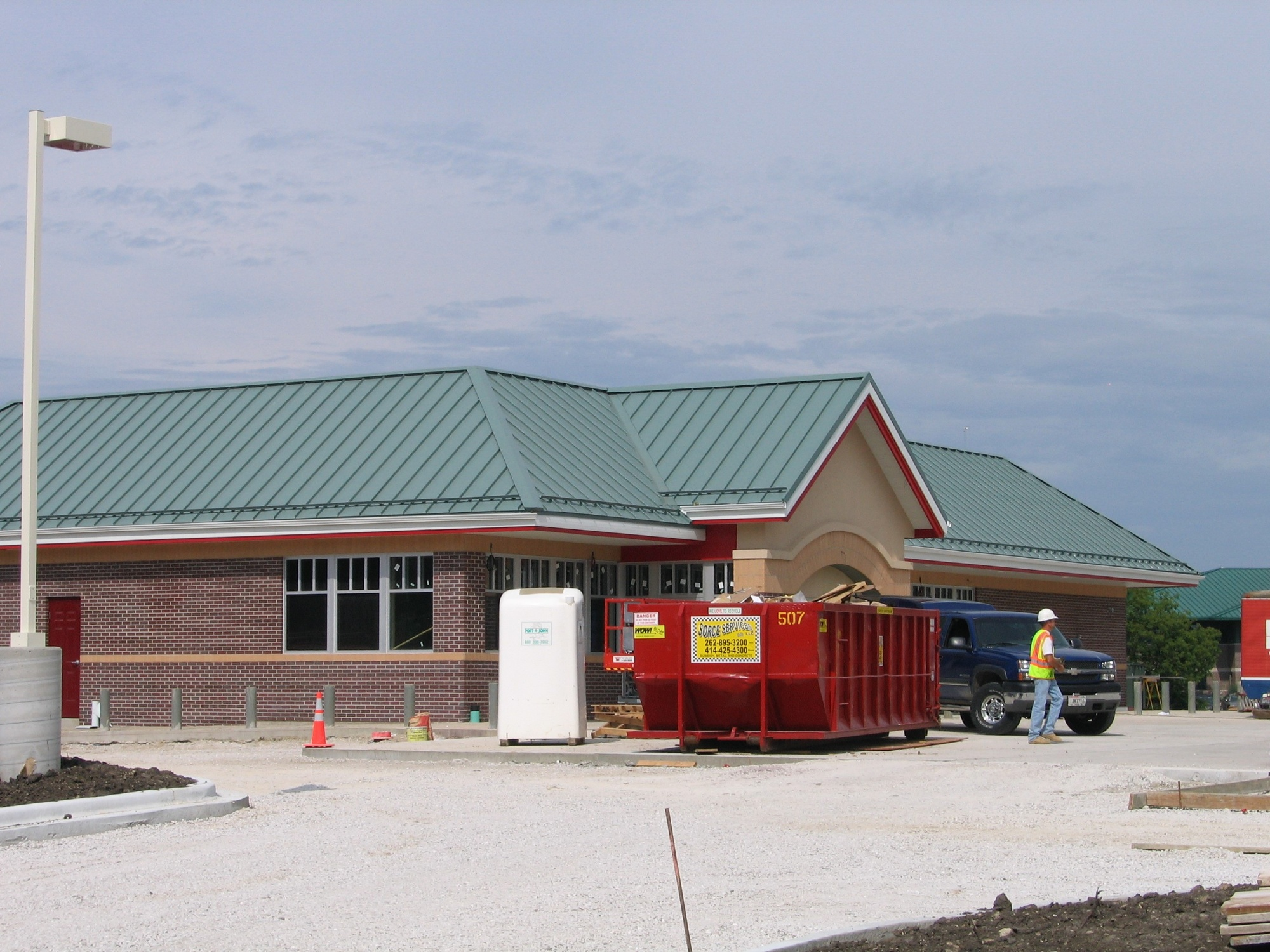 Metal roof on gas station installed by Alois Roofing