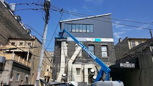 Architectural sheet metal siding installation on rooftop addition to downtown Milwaukee building
